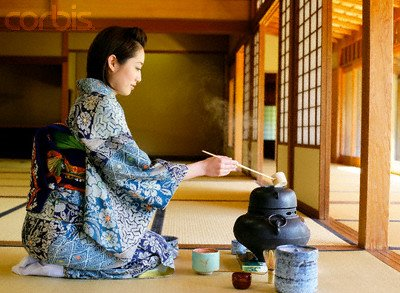 Japanese Woman in a Kimono Making Tea --- Image by © Bloomimage/Corbis